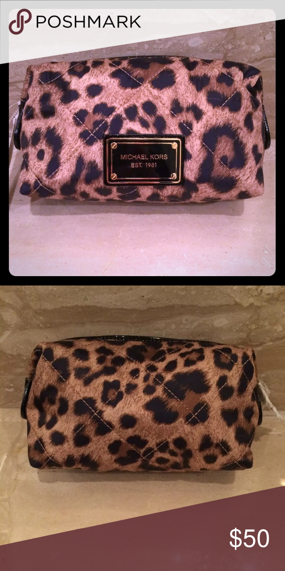 eae9c4a4b9 Michael Kors Quilted Large Leopard NWT Makeup Bag This is the large size...  Never used... NWT... Check out my closet for the medium sized one as well  (I ...