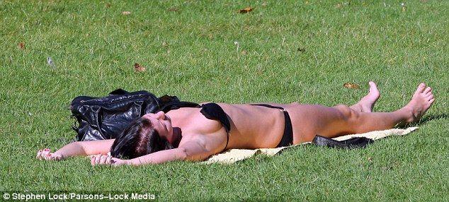 Wife Sunbathing In Garden