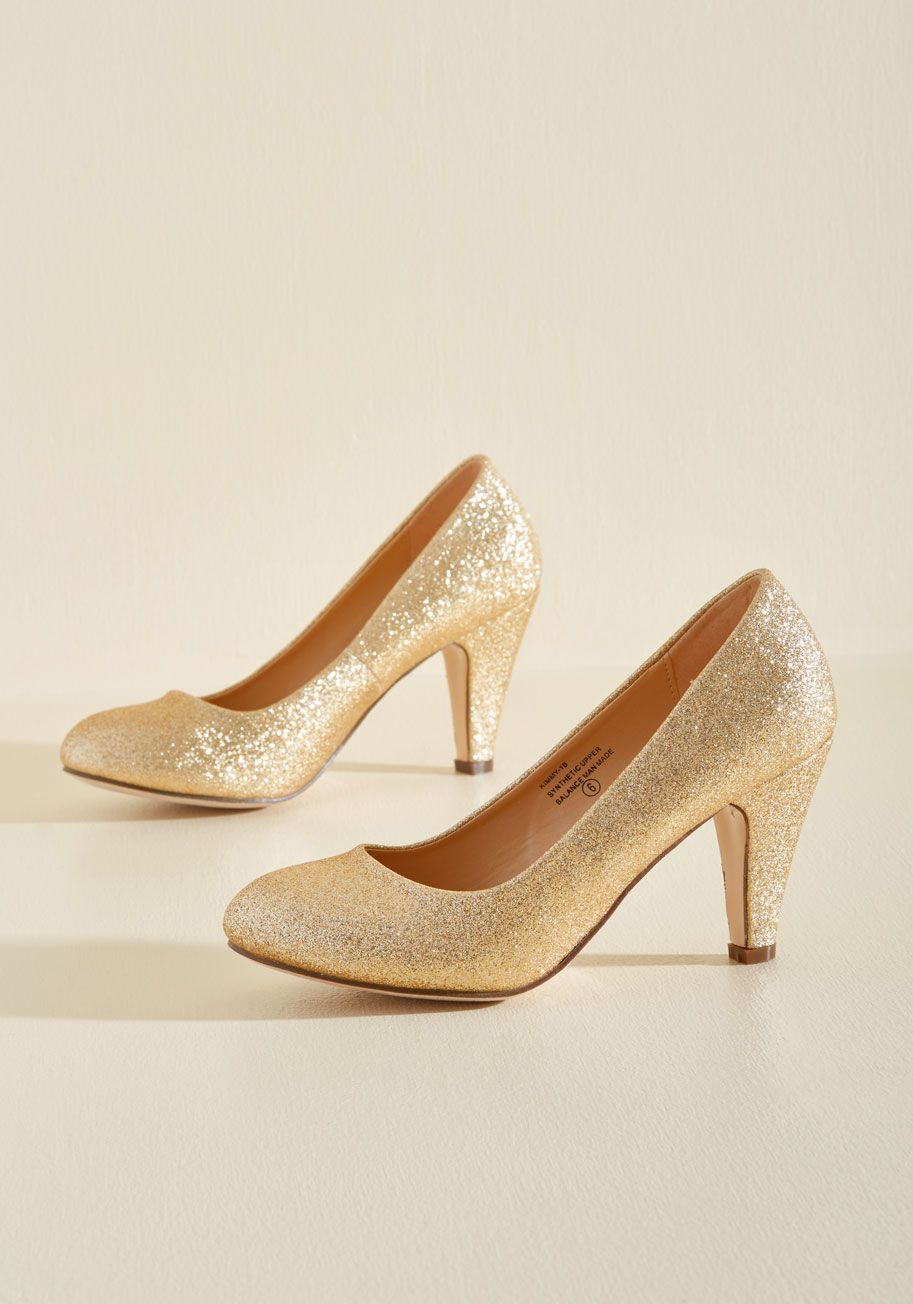 In a Classic of Its Own Heel in Gold Sparkle. Many shoes