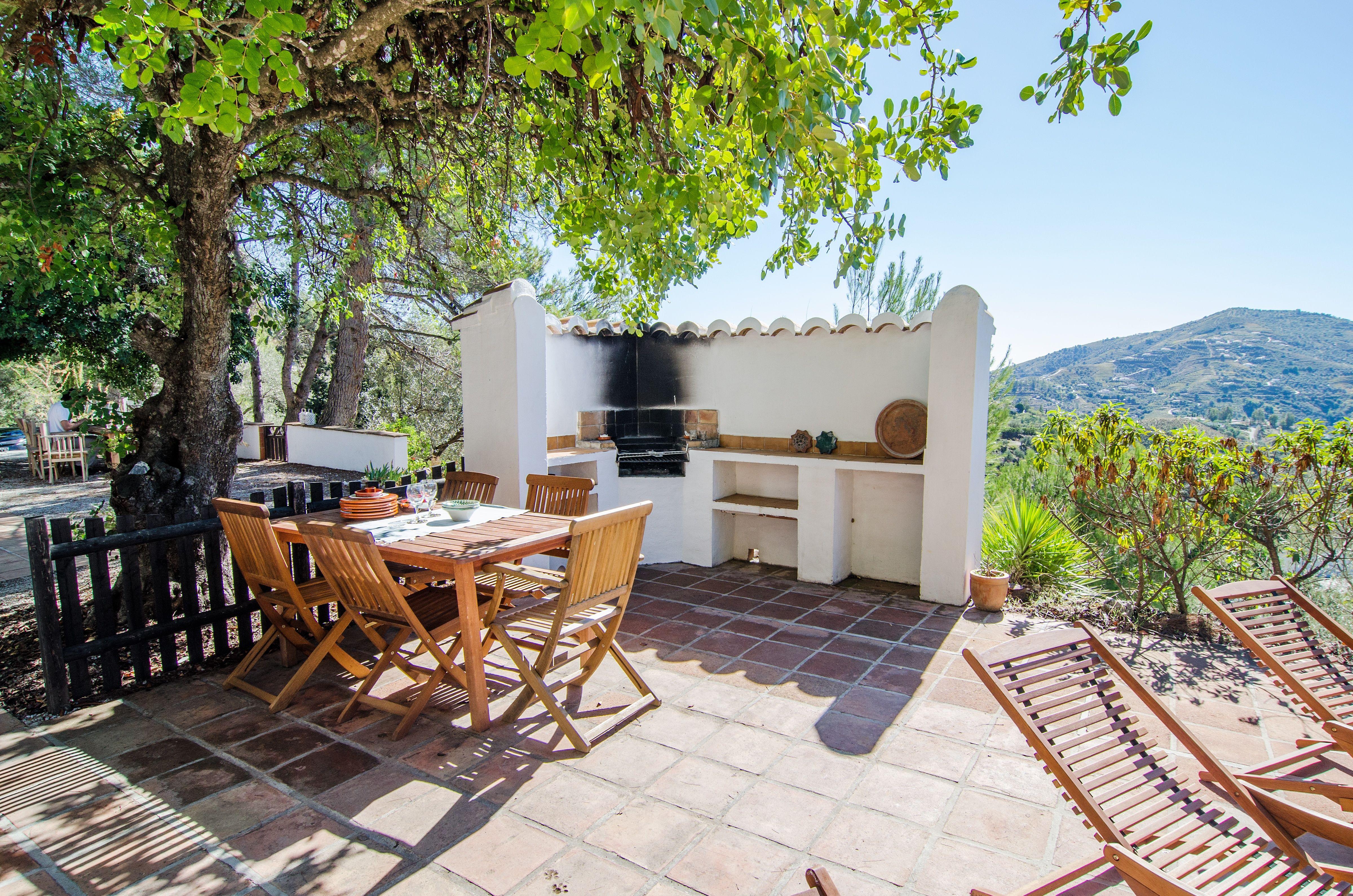 The outdoor kitchen at Holiday home Los dos Algarrobos