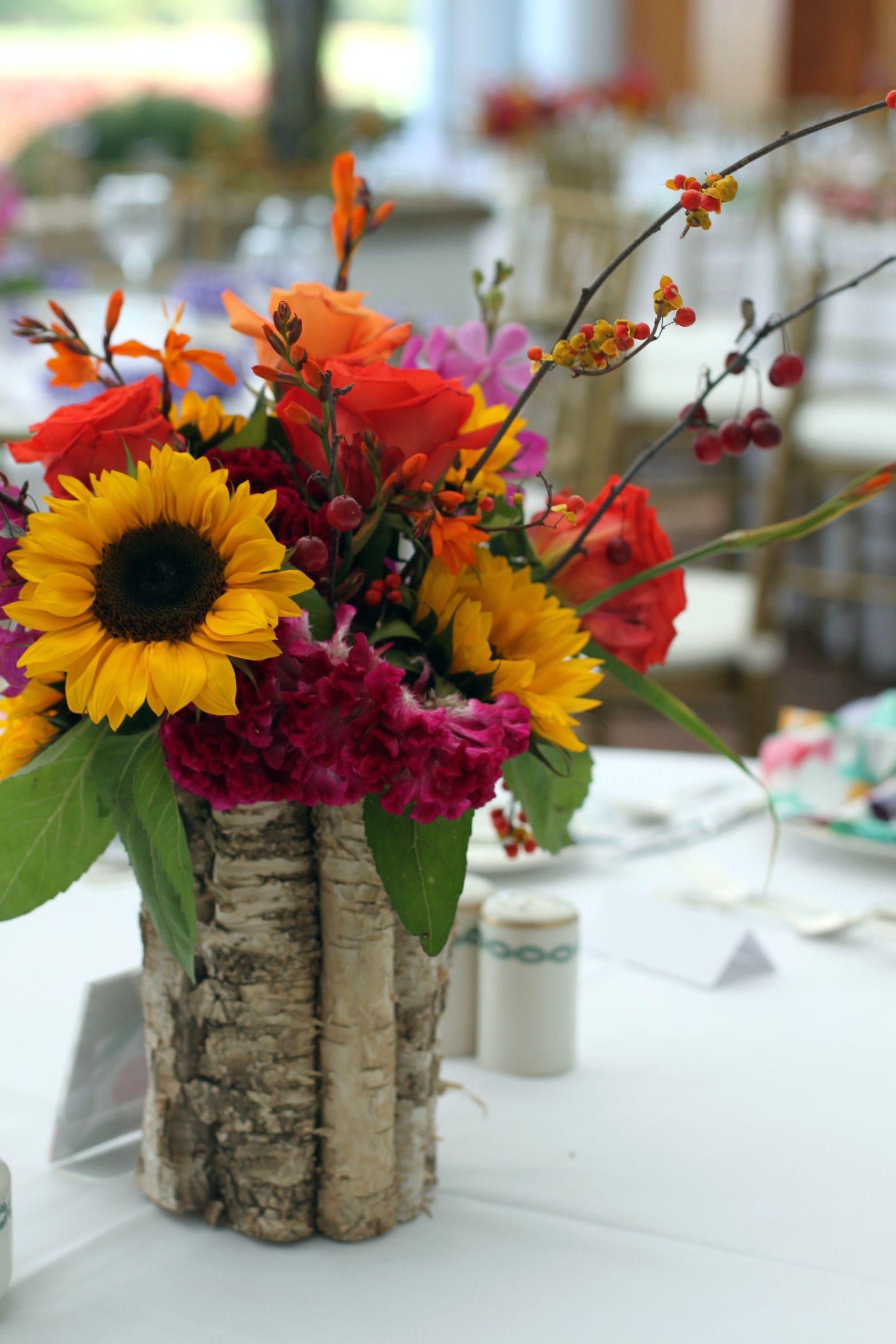 late summer fall wedding centerpiece orchid sunflower rose