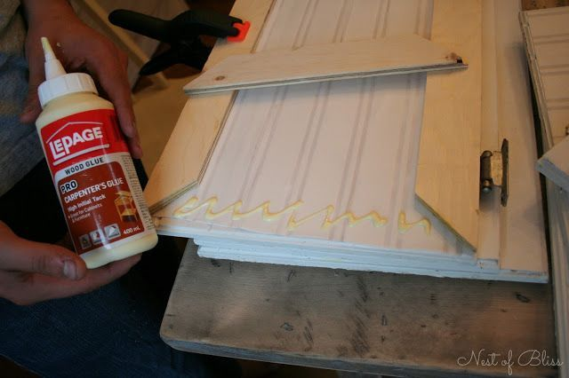 Budget Cabinet Makeover – Nest of Bliss. Beadboard paper & trim to reface doors, great tutorial