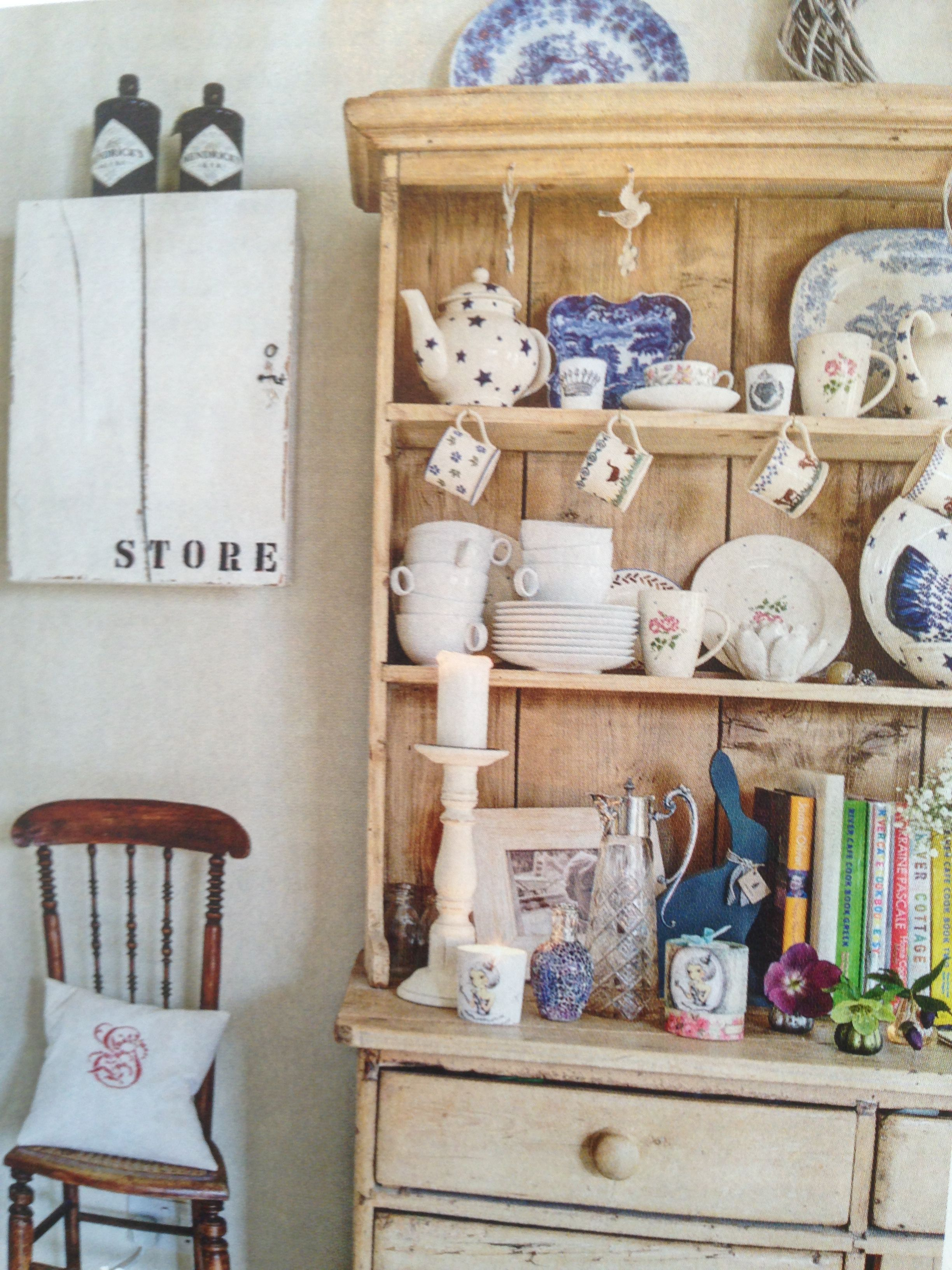 Kitchen Hutch Display With Hanging Teacups, Cookbooks, And Dishes I