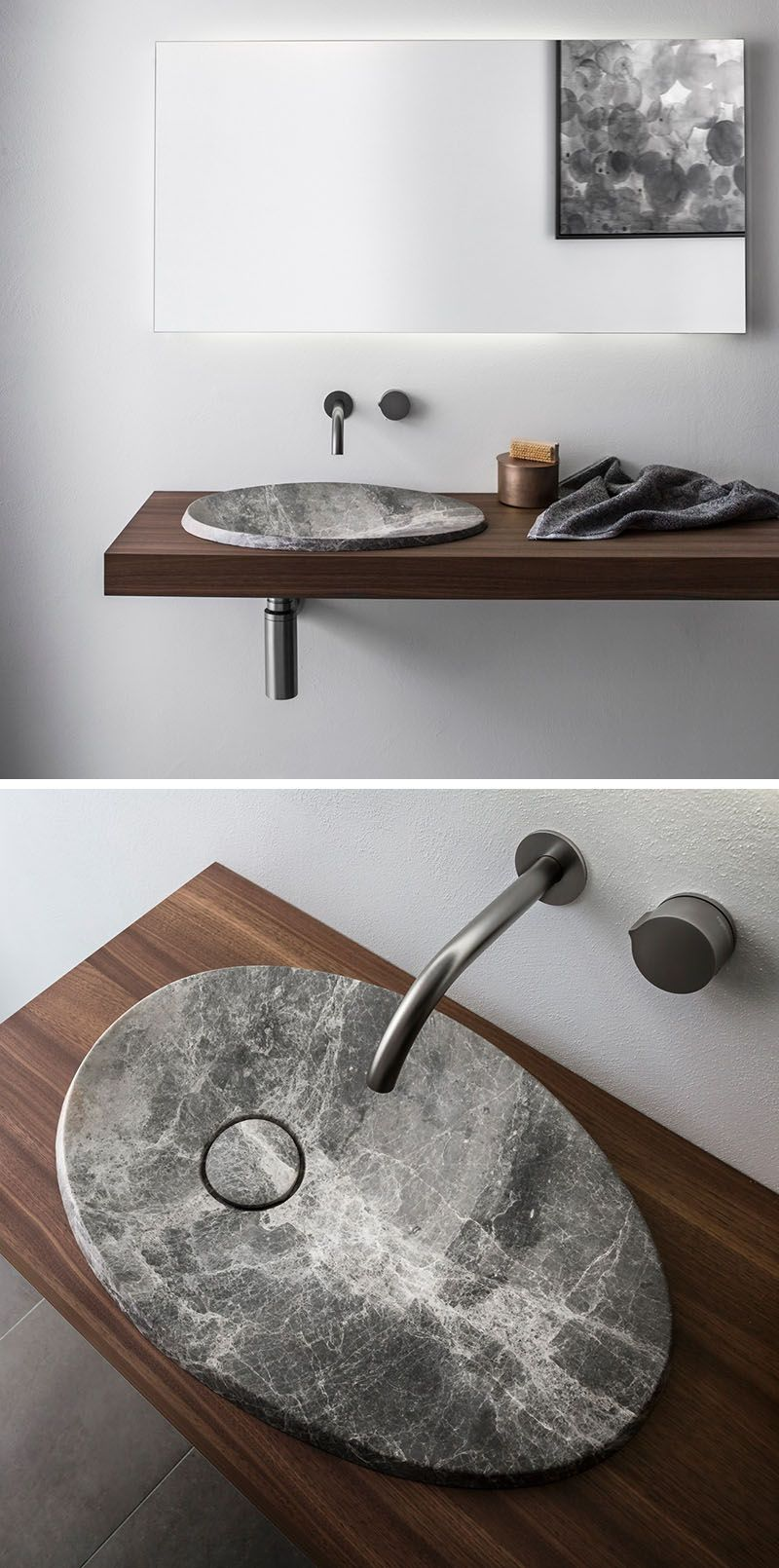 This modern bathroom sink made from natural stone sits on a ... on natural lighting bathroom, natural wood bathroom, natural bathroom products, natural stone bathroom, natural bathroom design ideas, natural tile bathroom,