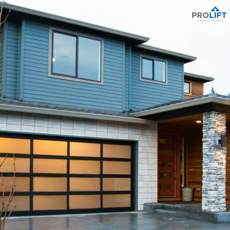Sleek And Contemporary This Modern Garage Door Perfectly Complements The Home In Style And Materials Clean Lines Framed In Black Alum Garage Doors Garage Door Makeover Modern Garage Doors