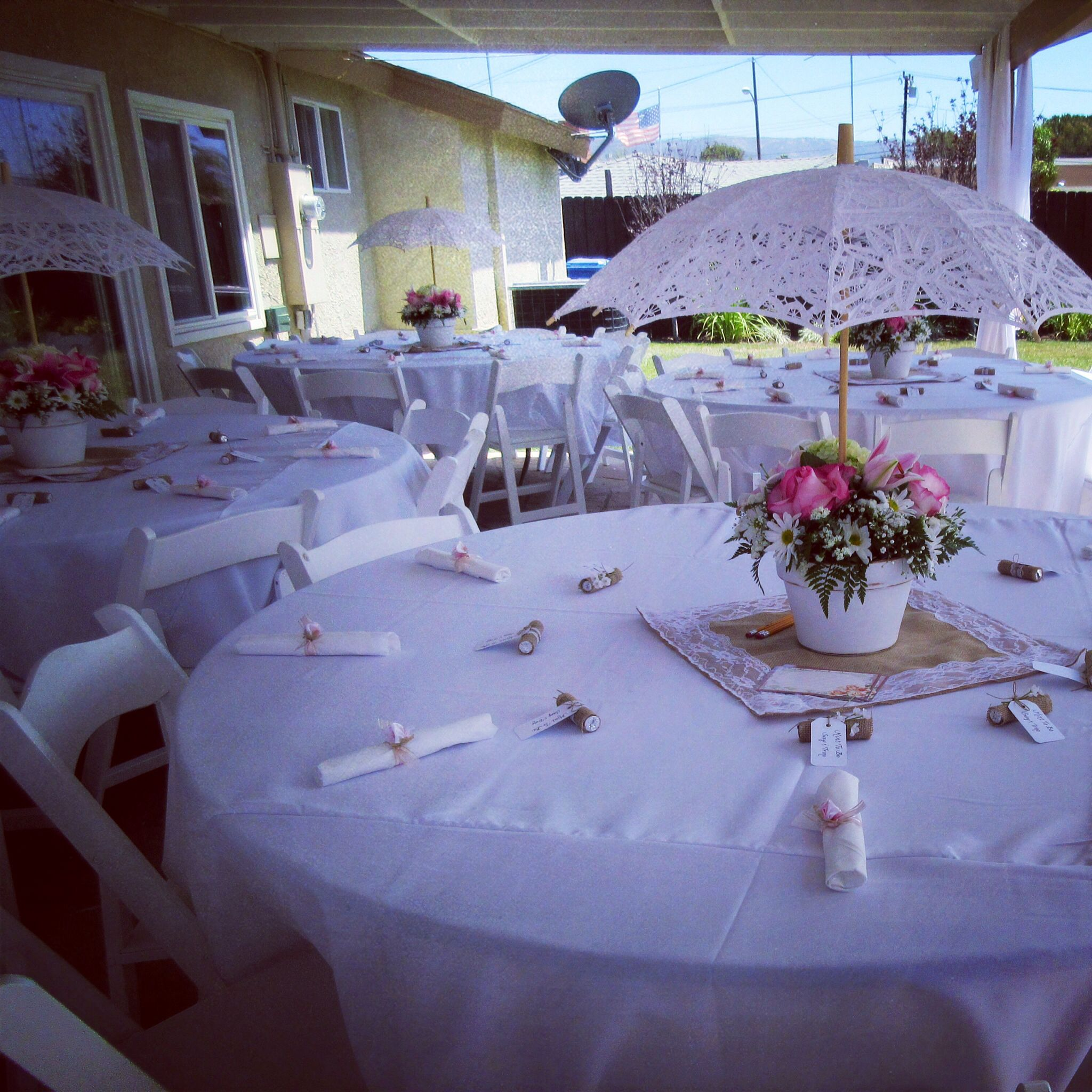 Pretty tables and umbrella centerpieces vintage theme for Patio table centerpiece ideas