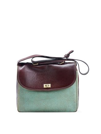 6be440212 Mosse Day Bag: This crackle turquoise bag with a contrasting brown leather  flap is spacious