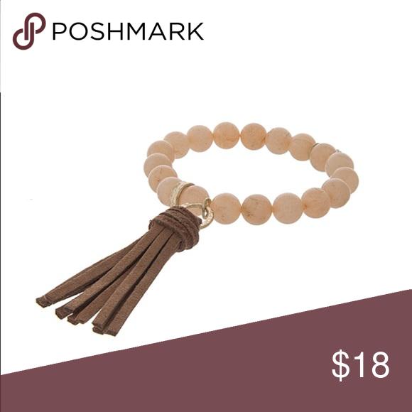 Peach stone brown tassel stretch bracelet Peach stone brown tassel stretch bracelet Jewelry Bracelets