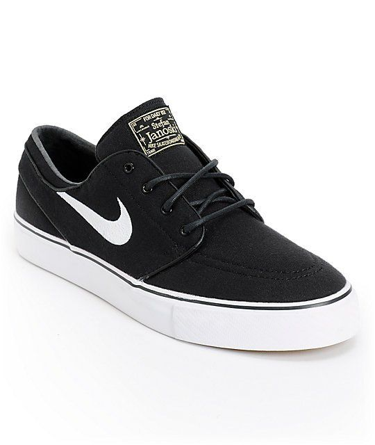 new product 7b3e9 d3a82 Low profile canvas Nike SB Zoom Stefan Janoski pro model skate shoes  feature a durable black canvas upper, double stitched perforated padded toe  cap, ...