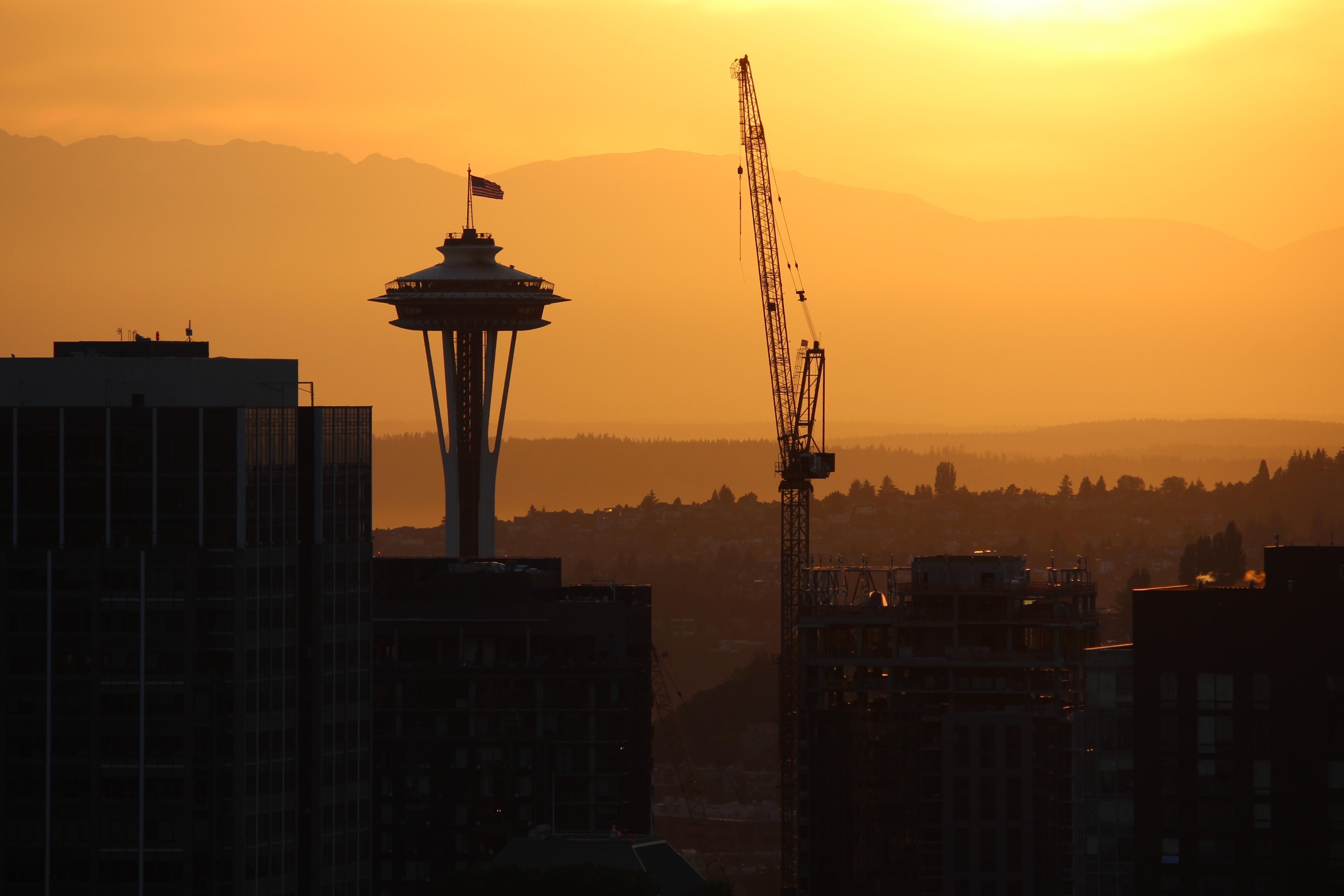 Space Needle and crane at sunset [OC]