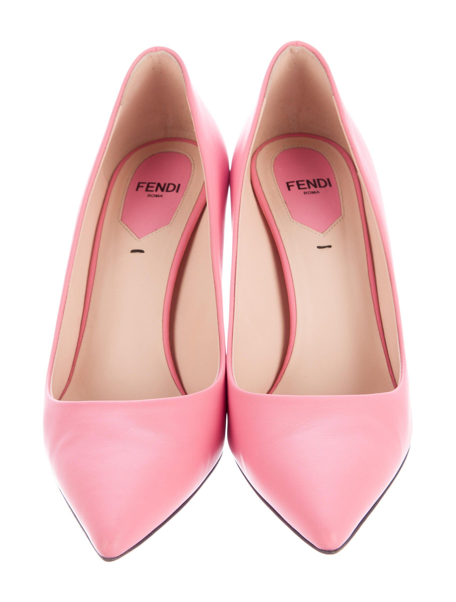97ec46642b Pink leather Fendi pointed-toe pumps with tonal stitching and stacked heels  featuring pequin-stripe accent. Includes box and additional heel taps.