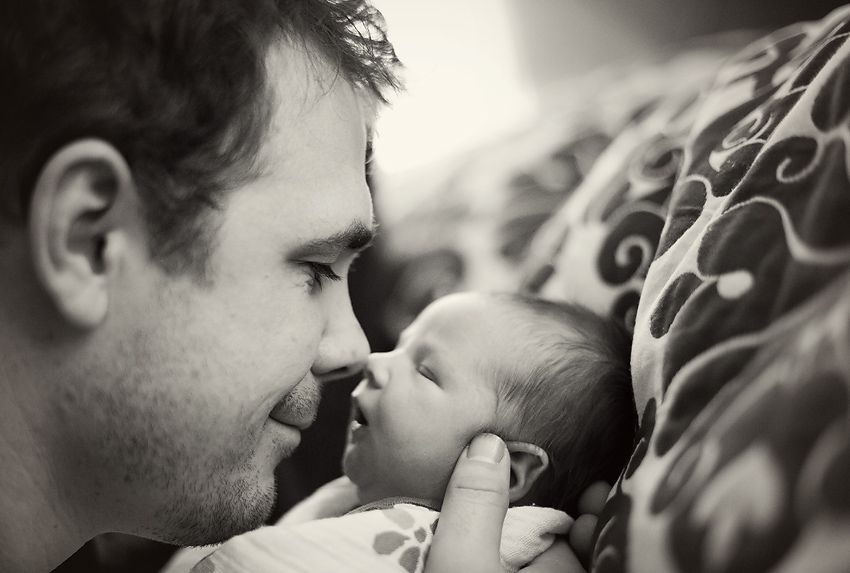 daddy touching newborns nose