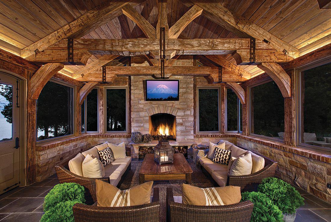 Rustic Sun Porch With Stone Fireplace