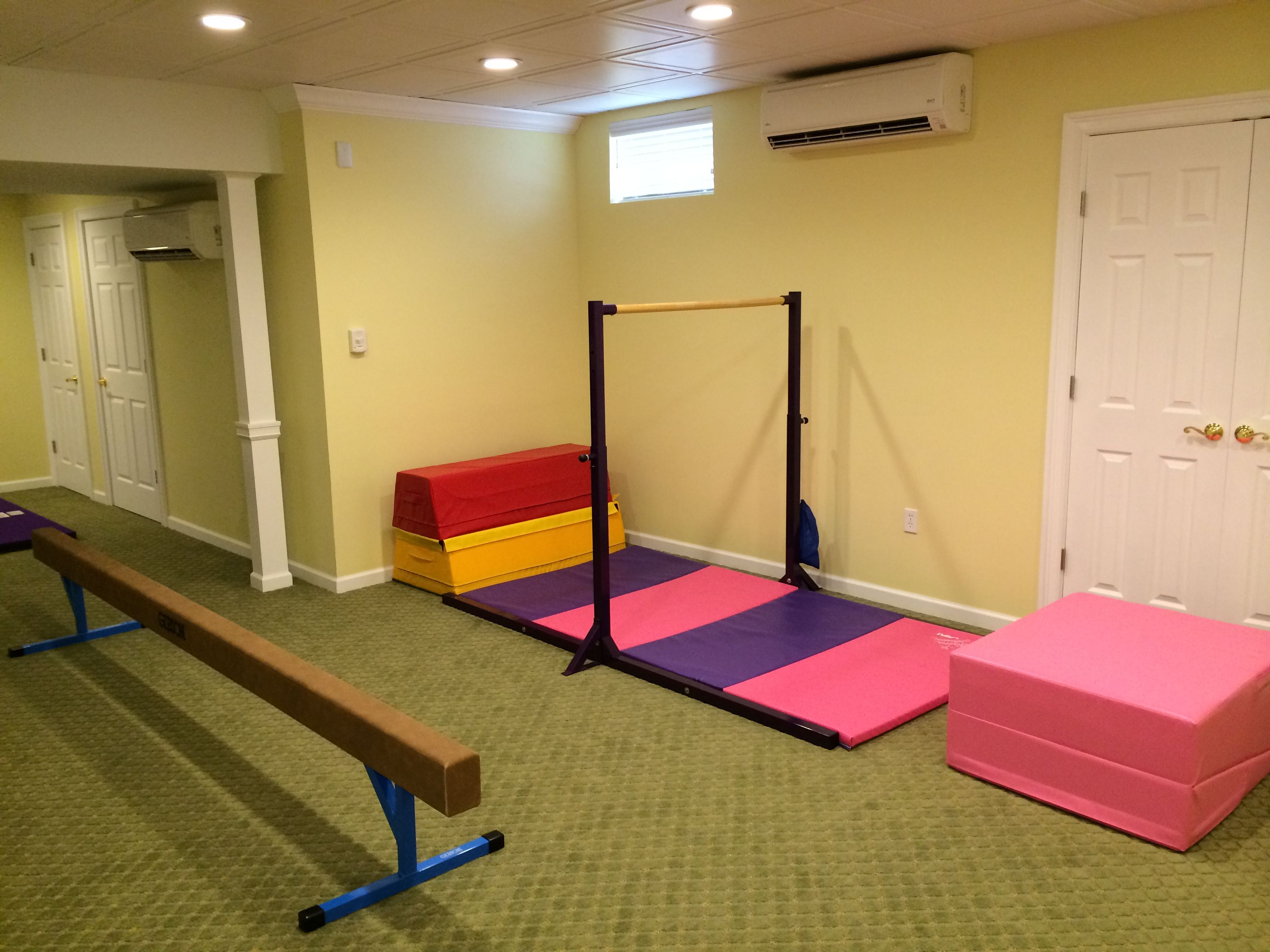 basement remodel with a kids gymnastics area