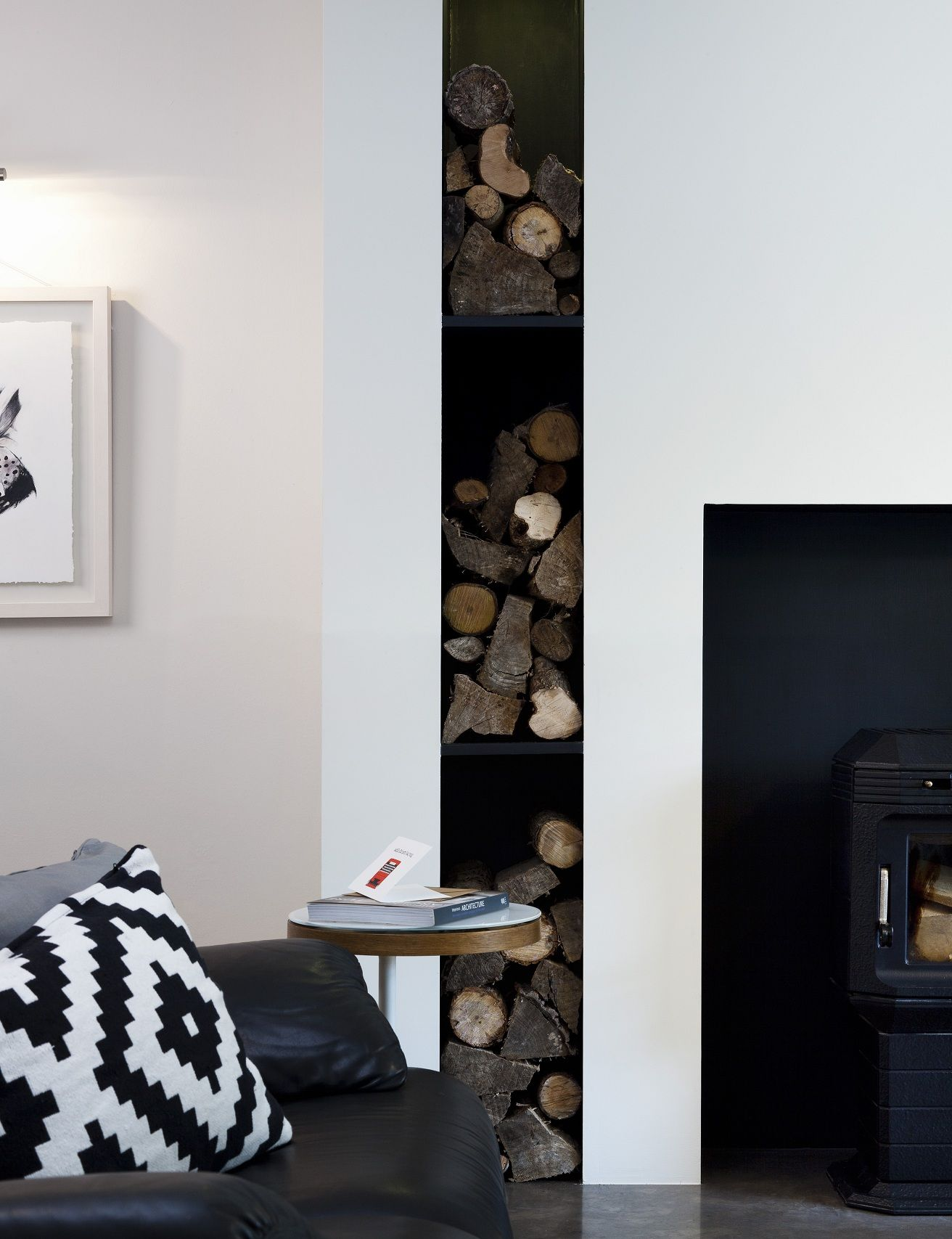 Achitectural fireplace wall with log storage feature area Mink