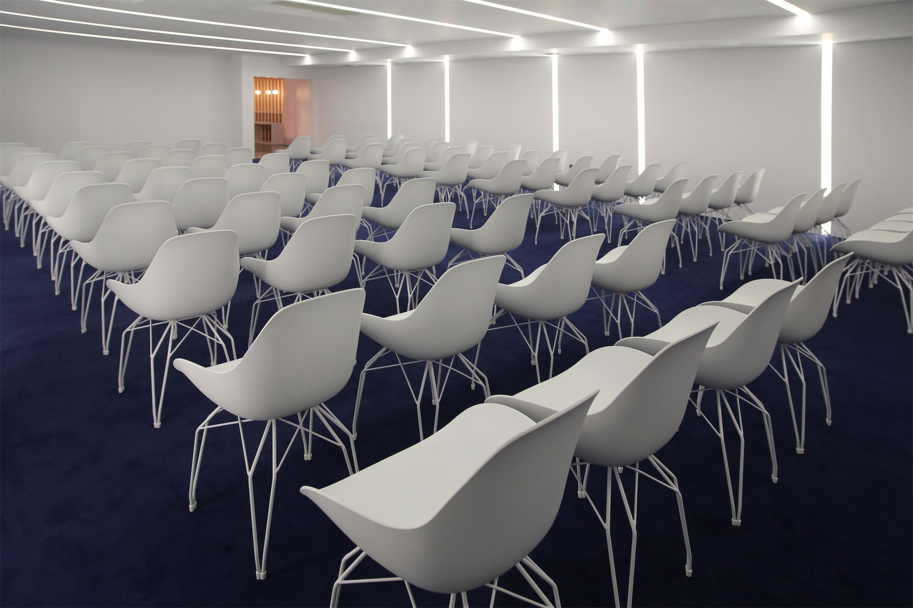 The interior of the conference room in the renovated Beiersdorf offices in Athens-Greece featuring the Kubikoff Diamond Dimple chairs and a careful implementation of roof lights to a low ceiling space. Design and implementation by the Love.it team.