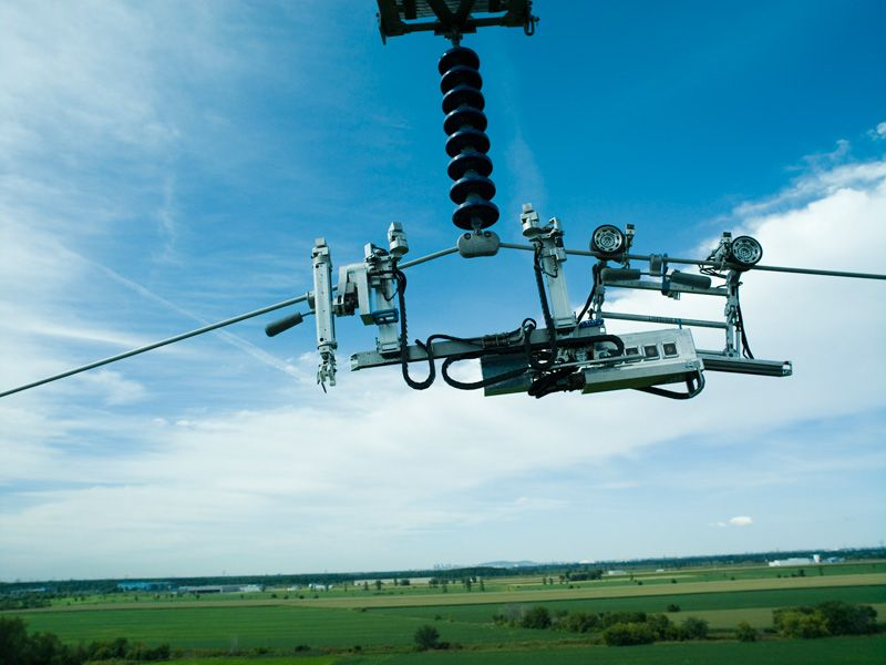 Linescout Robot For Inspecting Live Transmission Lines Uav Transmission Line Electricity