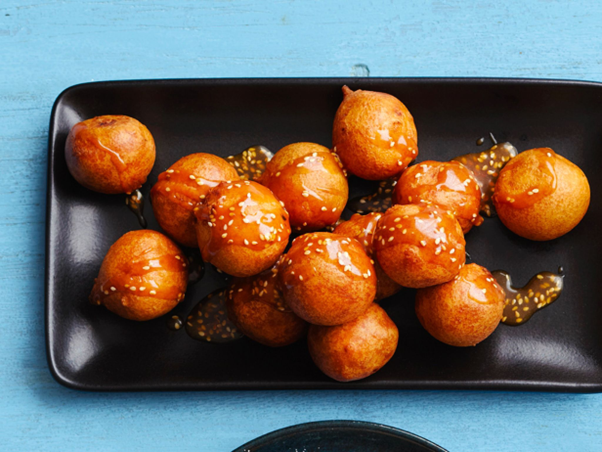 Rice Fritters with Sesame Caramel : A savory dish gets a sweet makeover with a caramel sauce that's flavored with sesame seeds and orange.