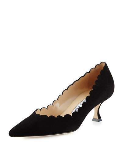 "Manolo Blahnik pump with suede upper. 2"" tapered heel. Pointed toe. Scalloped collar. Lightly cushioned insole. Smooth outsole. ""Srilasca"" is made in Italy."