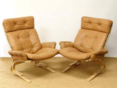 A Pair Of Danish Westnofa Chairs Finished In Buffalo Hide