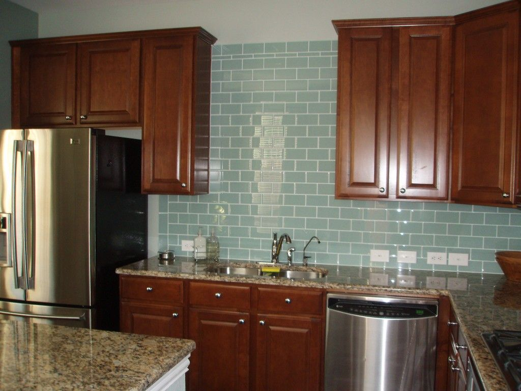 - Countertop Color Is Great, Backsplash Aqua Glass Tiles...YES! Just
