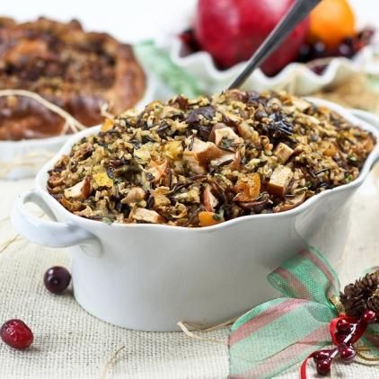 Stuffing turkey with minced meat, pine nuts , raisins ...