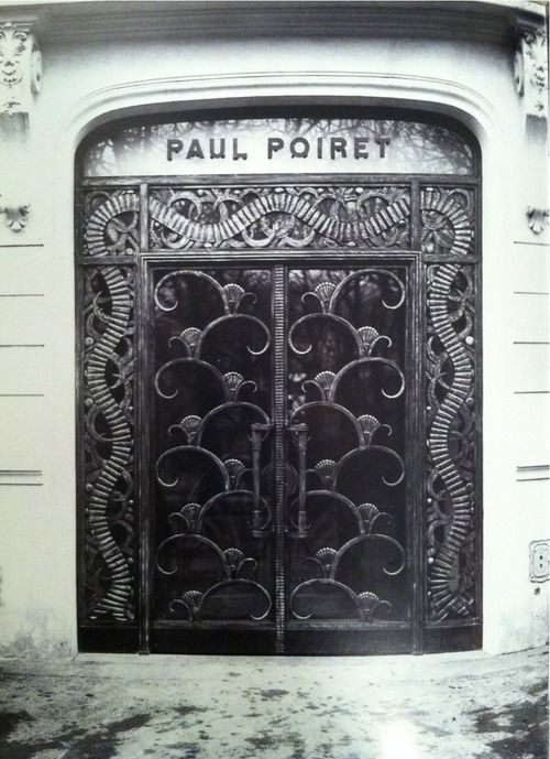 Paul Poiret opened his couture house in 1925 at the Rond-Point des Champs-Elysées. The Art Deco ribbon feature around the frame, designed by metal artist Edgar Brandt, are still in place.