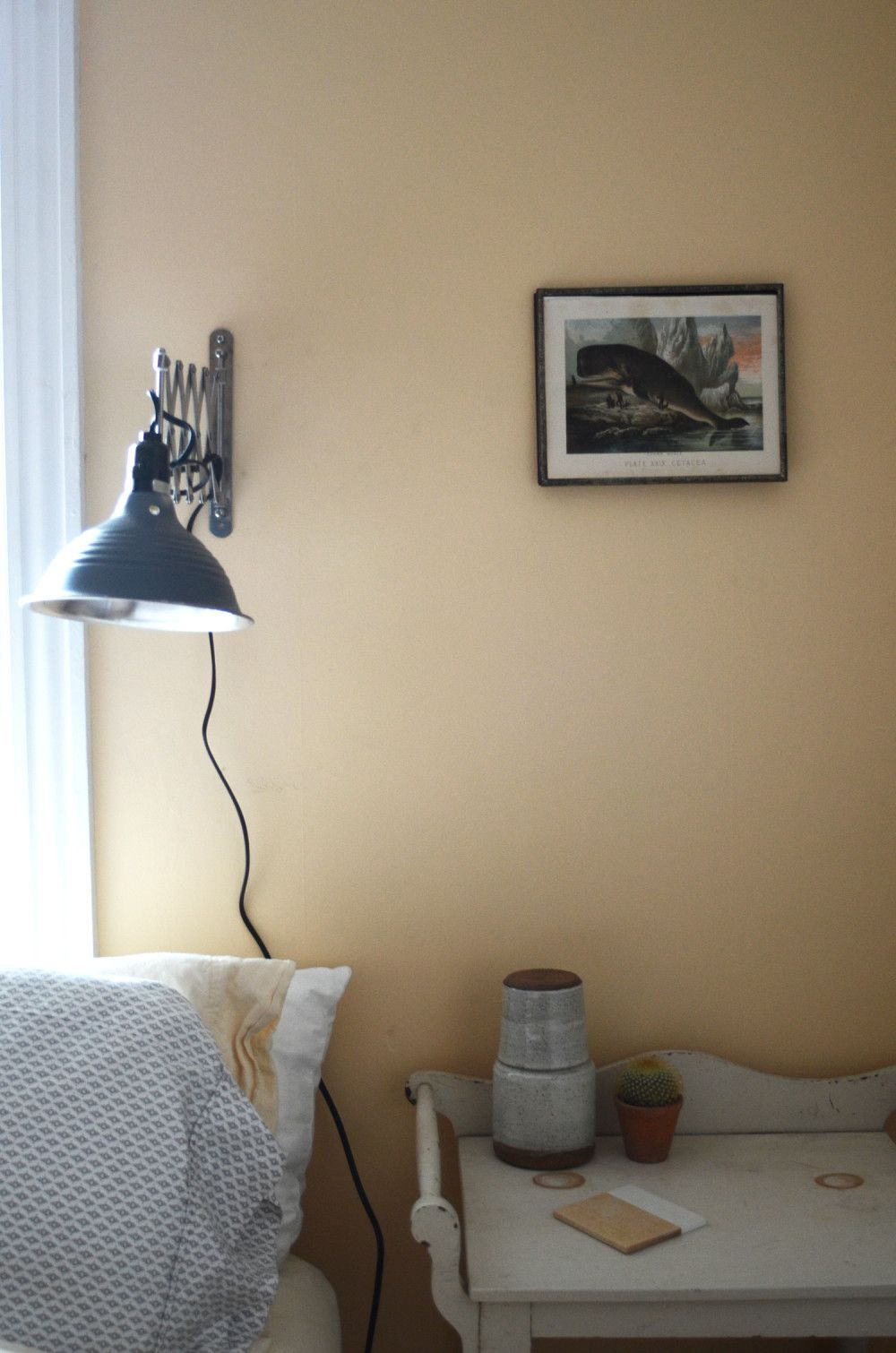 Bed light is made from an extendable IKEA mirror frame and