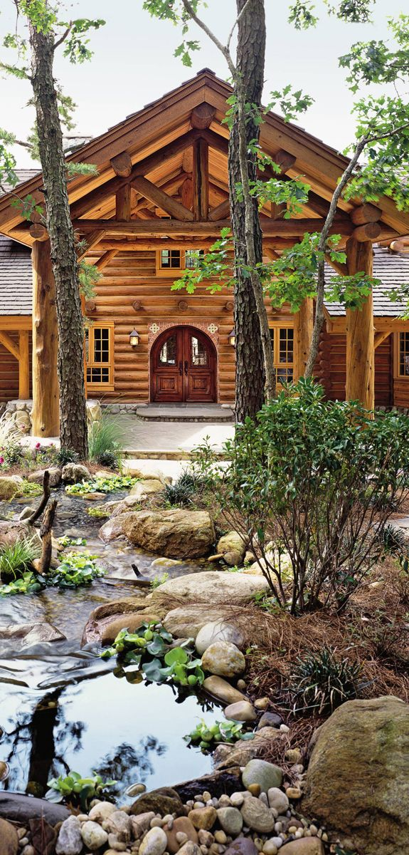 For her 18-acre horse farm in the Hamptons, Jill Rappaport worked with the Montana firm Pioneer Log Homes to design her 7,000-square-foot log house. The front, which features a Mexican double door and a substantial porte  cochère with exposed trussing, overlooks a water feature by Aquascape and River Rock Landscaping.
