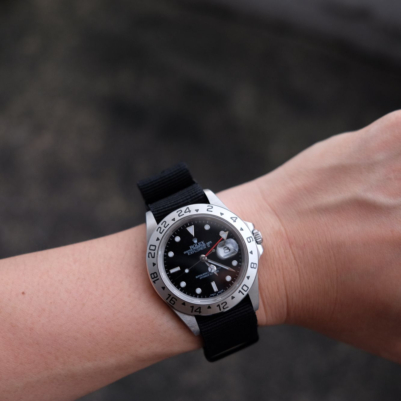 With Nato strap Black color with anodized buckles