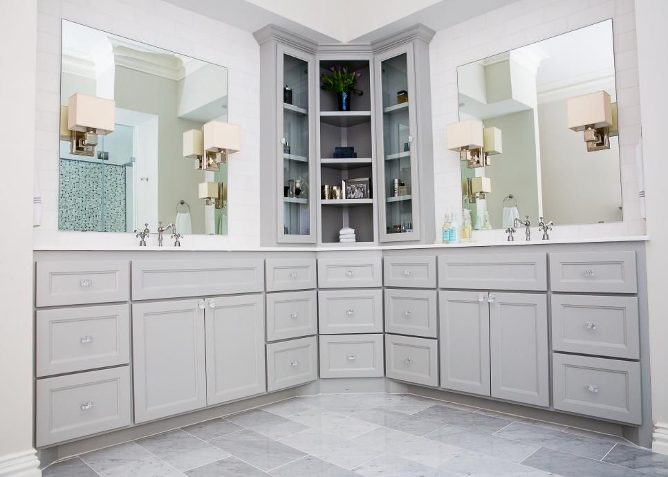 This remodeled bathroom features custom cabinetry with a