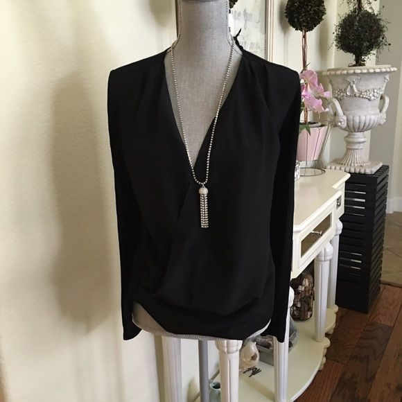 New - Drapy blouse This top is very chic with drapy front. Boxy wrap fit. Xs fits like small. Trouve Tops
