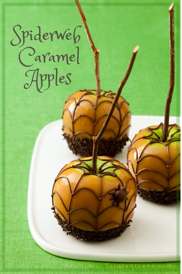Halloween Spiderweb Caramel Apples are a classic fall treat, with chocolatey, sweet little crawlers. These apples just got spooky! #caramelapples