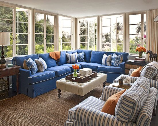 Love the blue sectional and Windows.