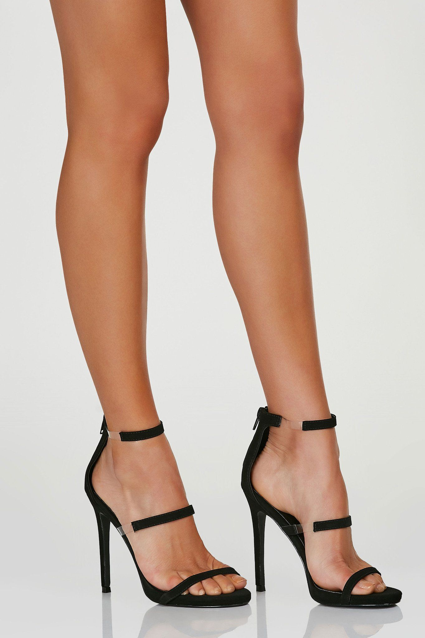 Sleek pair of three strap heels with contrast clear bands on each side.  Back zip