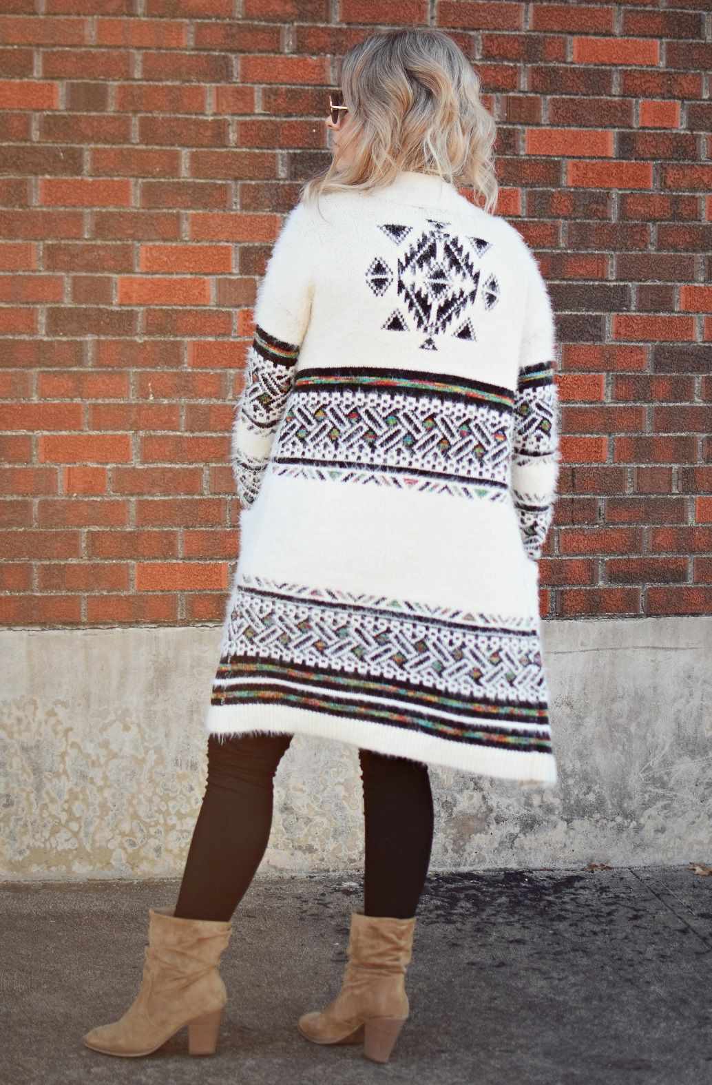 bohemian style cardigan sweater with black jeans and tan booties