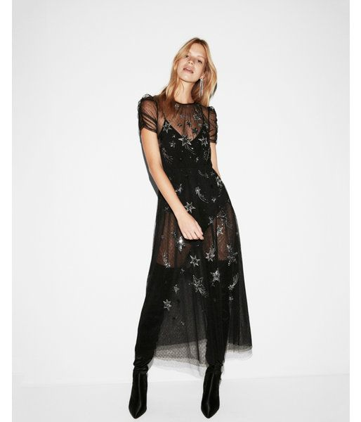 Get a sexy, stunning look that's ready for the runway with this bodysuit-meets-maxi dress. Star-kissed semi-sheer fabric offers a peek of the silky suit underneath, secured with two snap closures. Step out and make sure all eyes are on you.