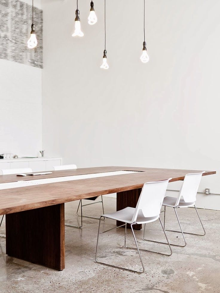 Ampoules plumen office boardroom table lighting bulbs white walls concrete like flooring
