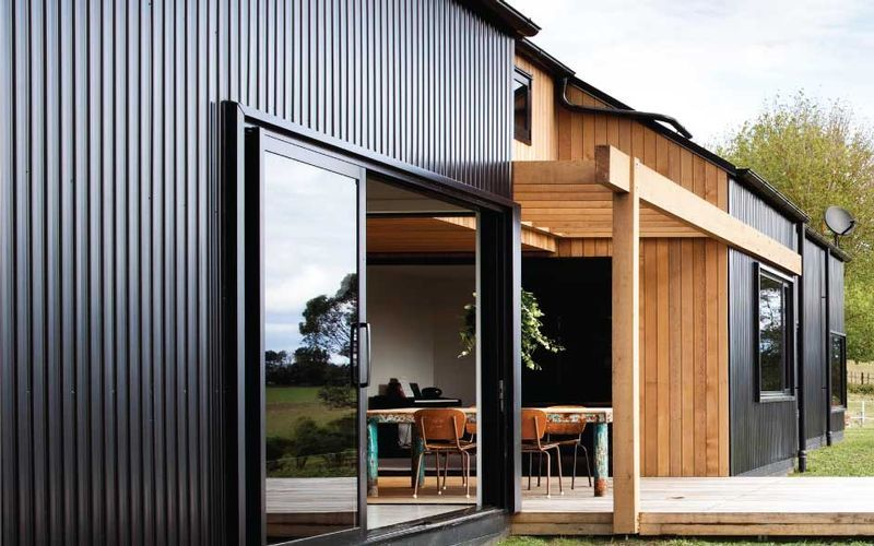 Stained Cedar Cladding Vertical With Metal Cladding