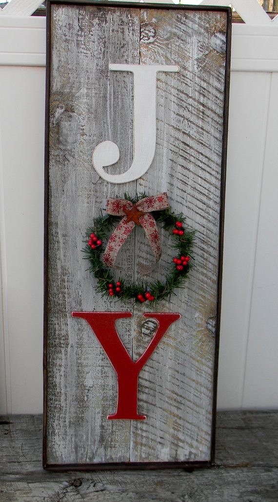 Rustic barn wood look Joy sign has a decorated wreath in place of ...