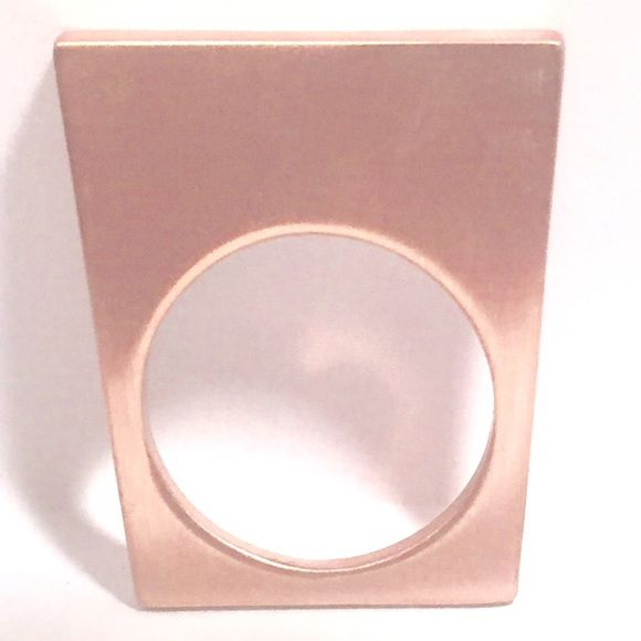 Rose Gold-Tone Ring Plated in rose gold gives this modern ring an old world twist.  Architectural and edgy this ring will literally stand out in a crowd. Jewelry Rings