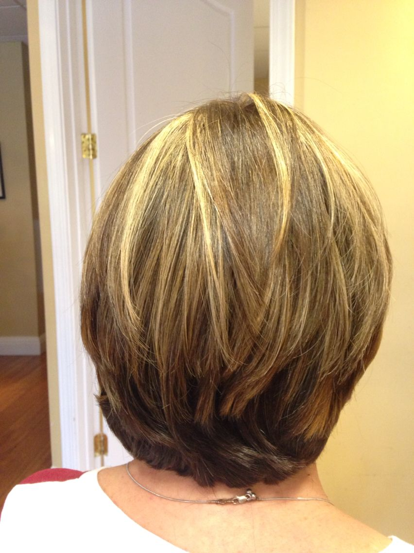Short hair cut and style covered up the gray hair with a rich brown