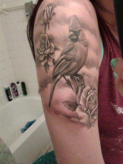 b249cf6429679 Cardinal rose tattoo I have. #tattoo #tattooidea #roses #rosetattoo #bird  #blackgreytattoo