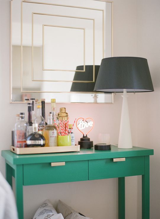 Attractive Gorgeous Dining Room With Emerald Green Console Table Accented With Gold  Hardware Topped With Gold Bar