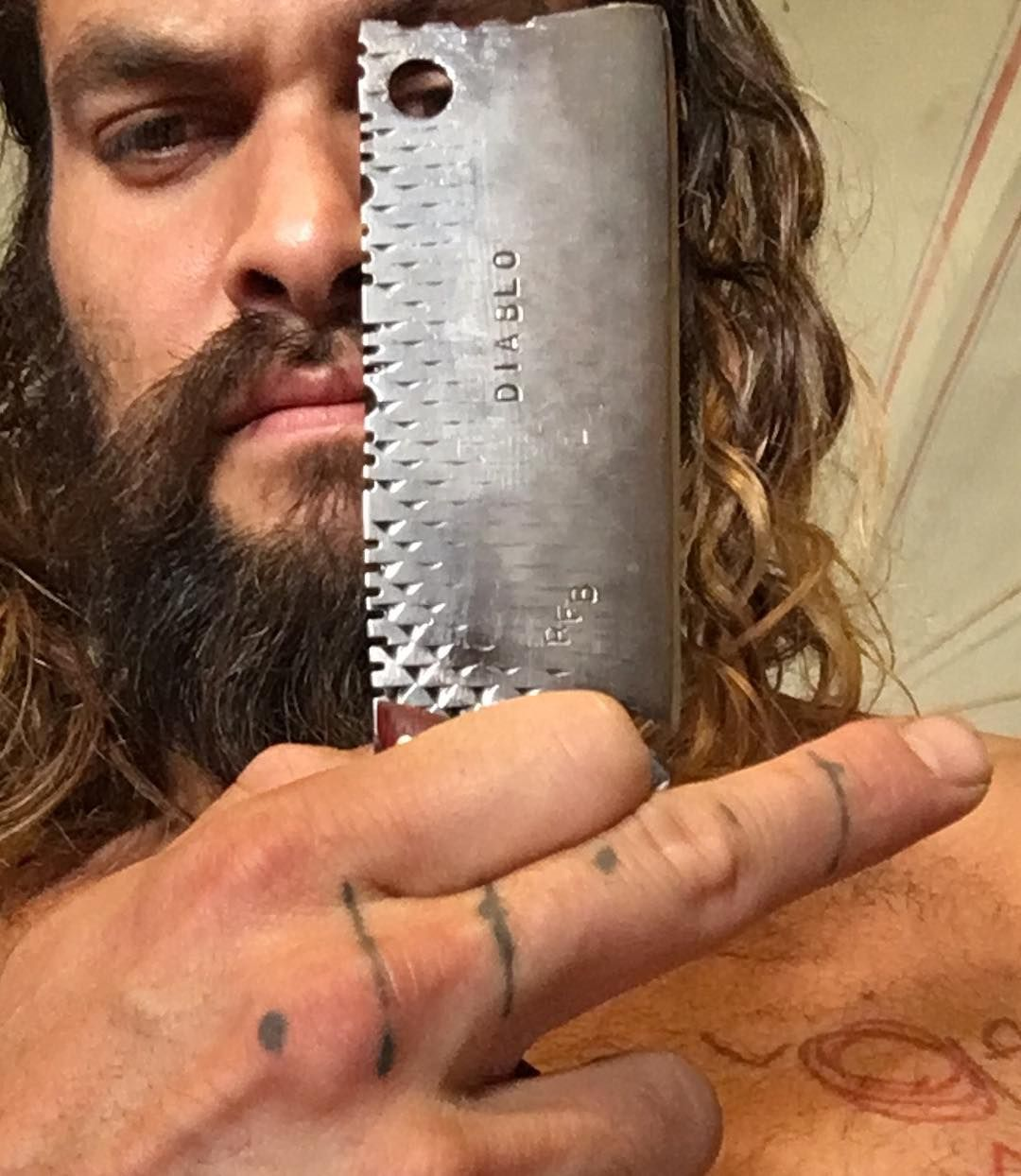 62ebcdbbc Between his bulging biceps and plentiful faux-tattoos in the Justice League  trailer, you may have overlooked actor Jason Momoa's real ink . . . but  he's no