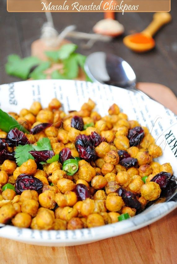 Spiced up baked chickpeas with cayenne pepper and garam masala. Guilt free and totally addictive.