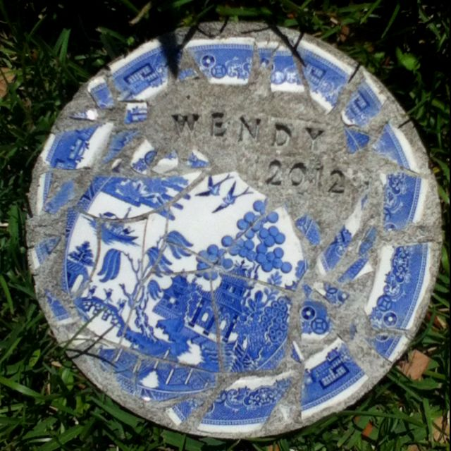 DIY stepping stone. My mother broke the spode blue willow plate I gave her for mothers day so I made it into a stepping stone.