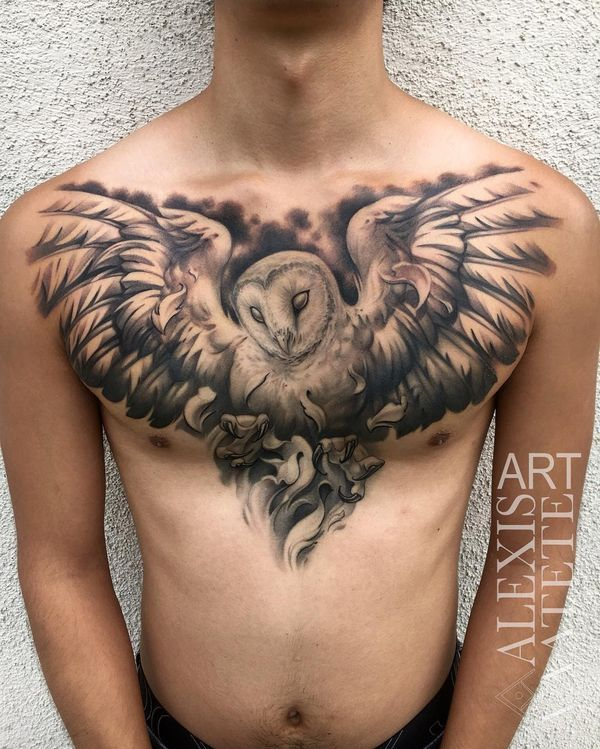 The Flying Black And Gray Owl Tattoo On The Chest