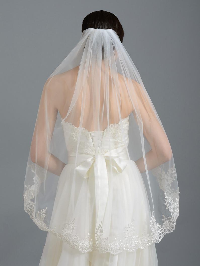 33 Beautiful Ivory Wedding Dress With White Veil Best Inspiration [ 1980 x 1320 Pixel ]