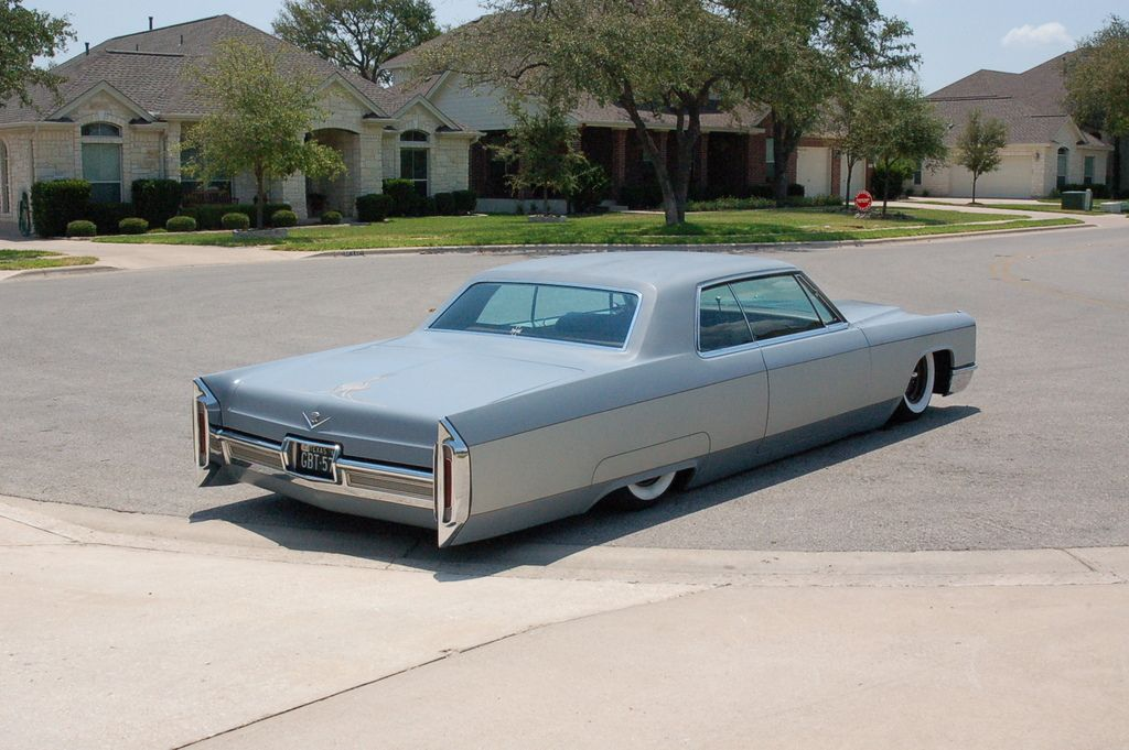 66 Cadillac Coupe DeVille It was yellow with a black top and